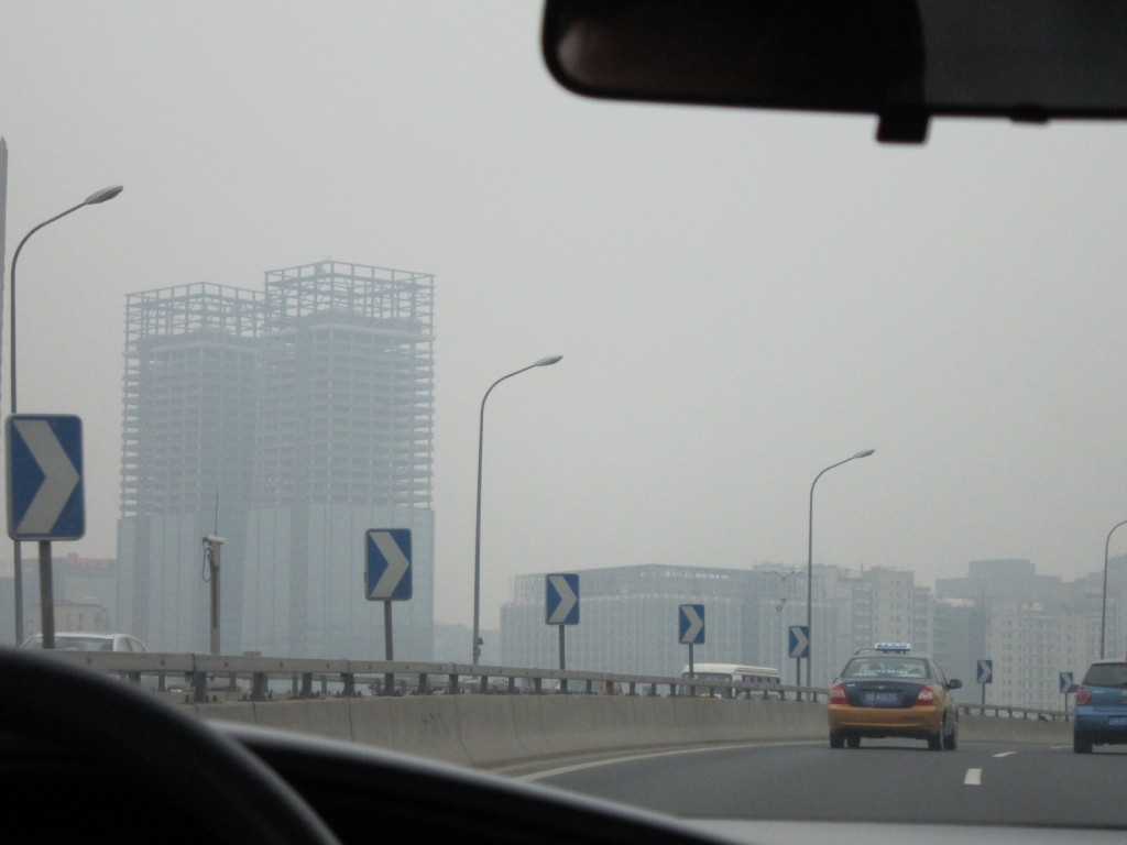 ...the famous Beijing smog makes the buildings somewhat difficult to see.