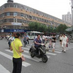 Crossing the street in China is fun. The light is green, but you still have to get through...